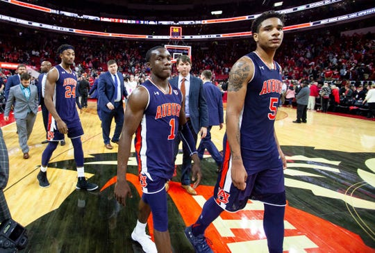 Auburn's Chuma Okeke (5), Jared Harper (1) and Anfernee McLemore (24) walk off the court after losing 78-71 to North Carolina State in an NCAA college basketball game in Raleigh, N.C., Wednesday, Dec. 19, 2018.