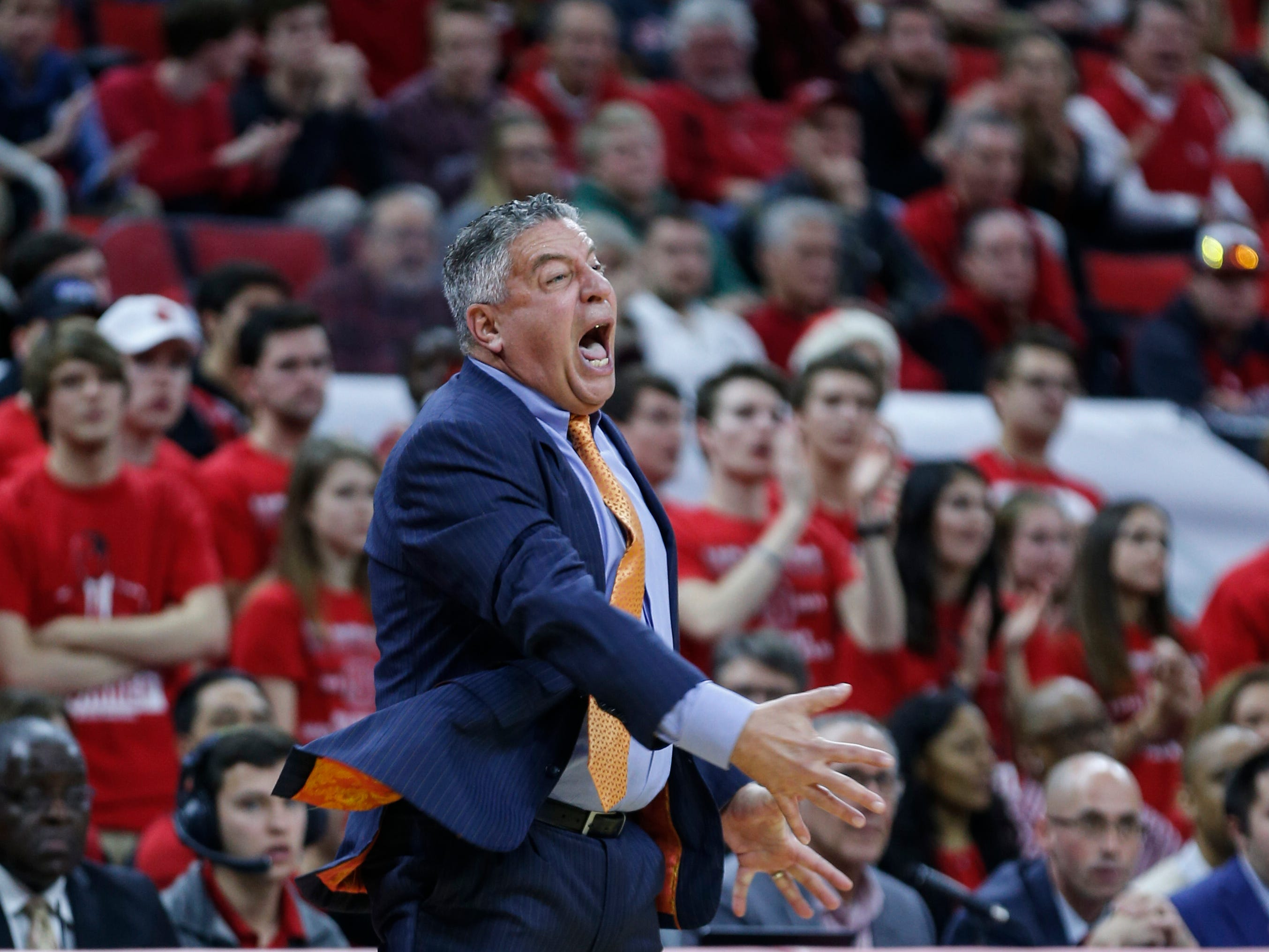 Dec 19, 2018; Raleigh, NC, USA; Auburn Tigers head coach Bruce Pearl yells to his team against the North Carolina State Wolfpack in the first half at PNC Arena. Mandatory Credit: Nell Redmond-USA TODAY Sports