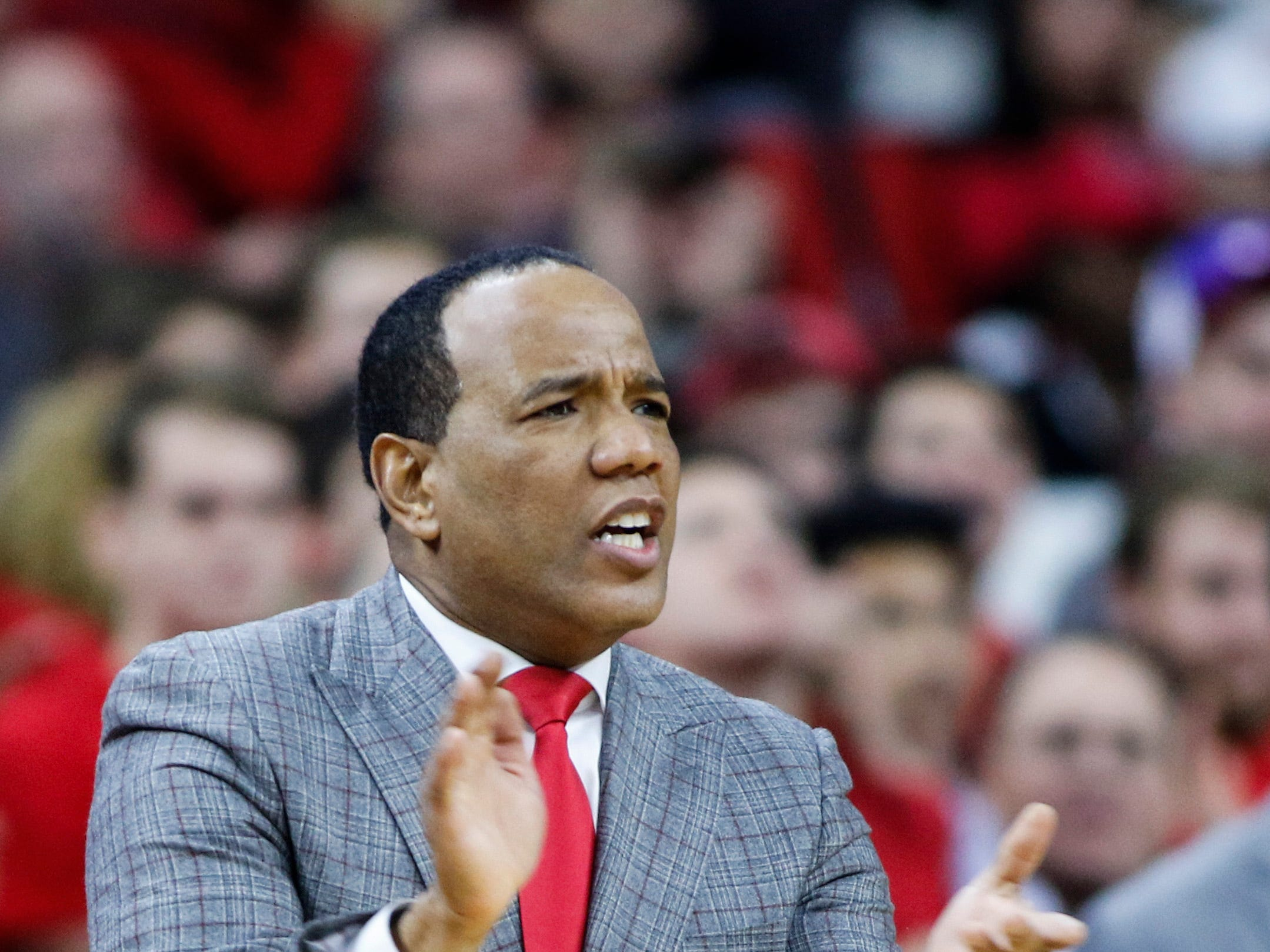 Dec 19, 2018; Raleigh, NC, USA; North Carolina State Wolfpack head coach Kevin Keatts encourages his team as they play against the Auburn Tigers in the second half at PNC Arena. The North Carolina State Wolfpack won 78-71. Mandatory Credit: Nell Redmond-USA TODAY Sports