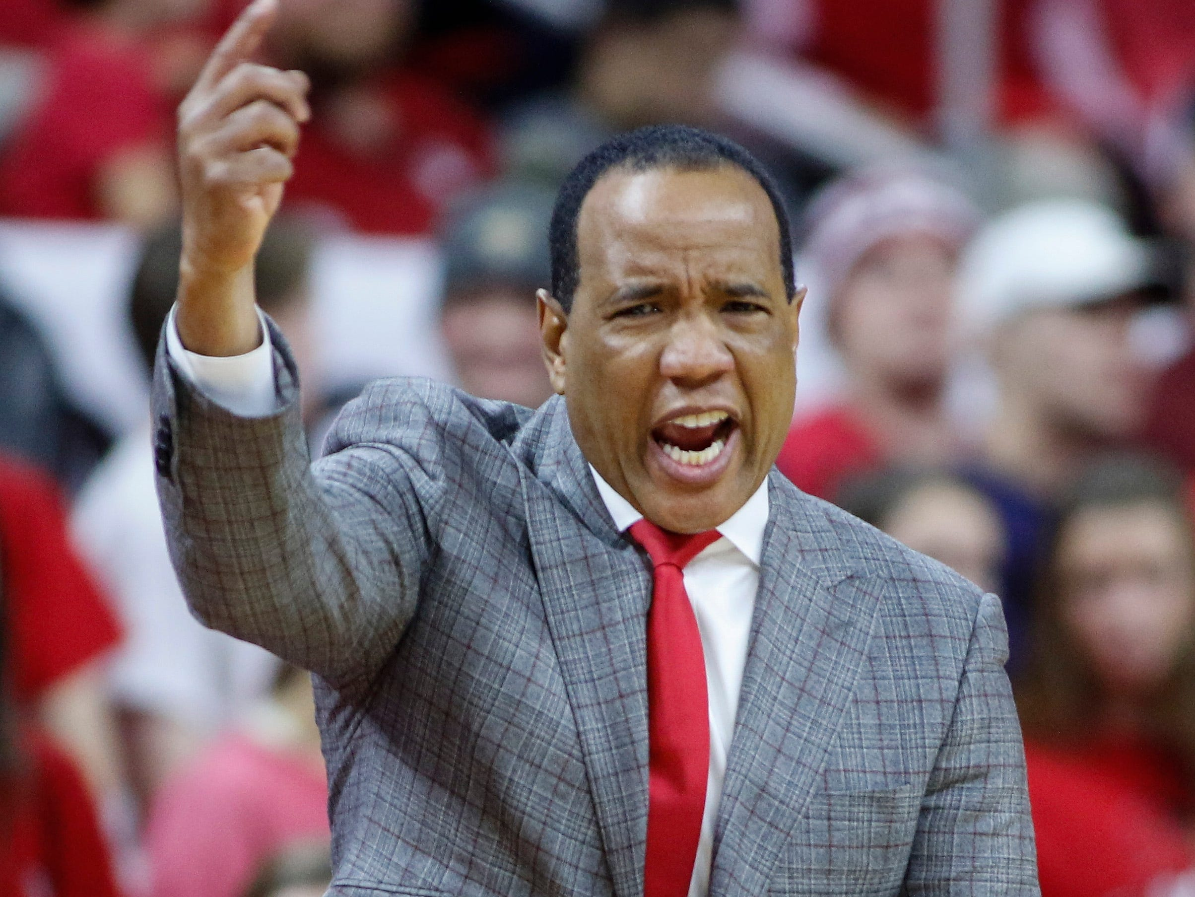 Dec 19, 2018; Raleigh, NC, USA; North Carolina State Wolfpack head coach Kevin Keatts directs his team against the Auburn Tigers in the first half at PNC Arena. Mandatory Credit: Nell Redmond-USA TODAY Sports