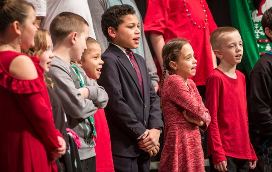 Grissom Elementary students take part in their Holiday program Wednesday night at Southside Middle School.