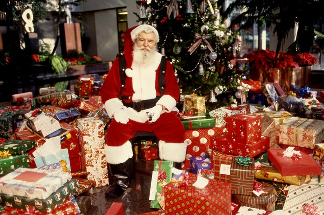 Santa Claus, known during the off-season as Ed Walsh, is ready to greet the employees and guests of Northern Telecom for their annual Christmas party on Dec. 9, 1988, at their Nashville headquarters.
