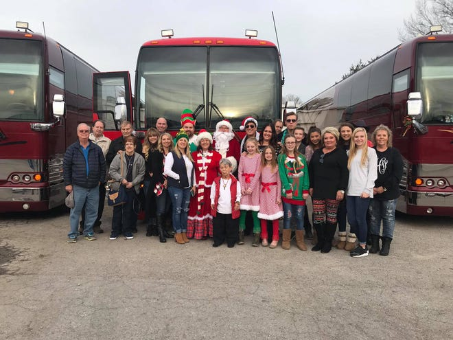 Musician Ronnie McDowell, the Portland Police Department and All Access Coach Leasing took Portland children Christmas shopping Dec. 19 for the Ronnie McDowell Annual Shopping Tour for Kids.