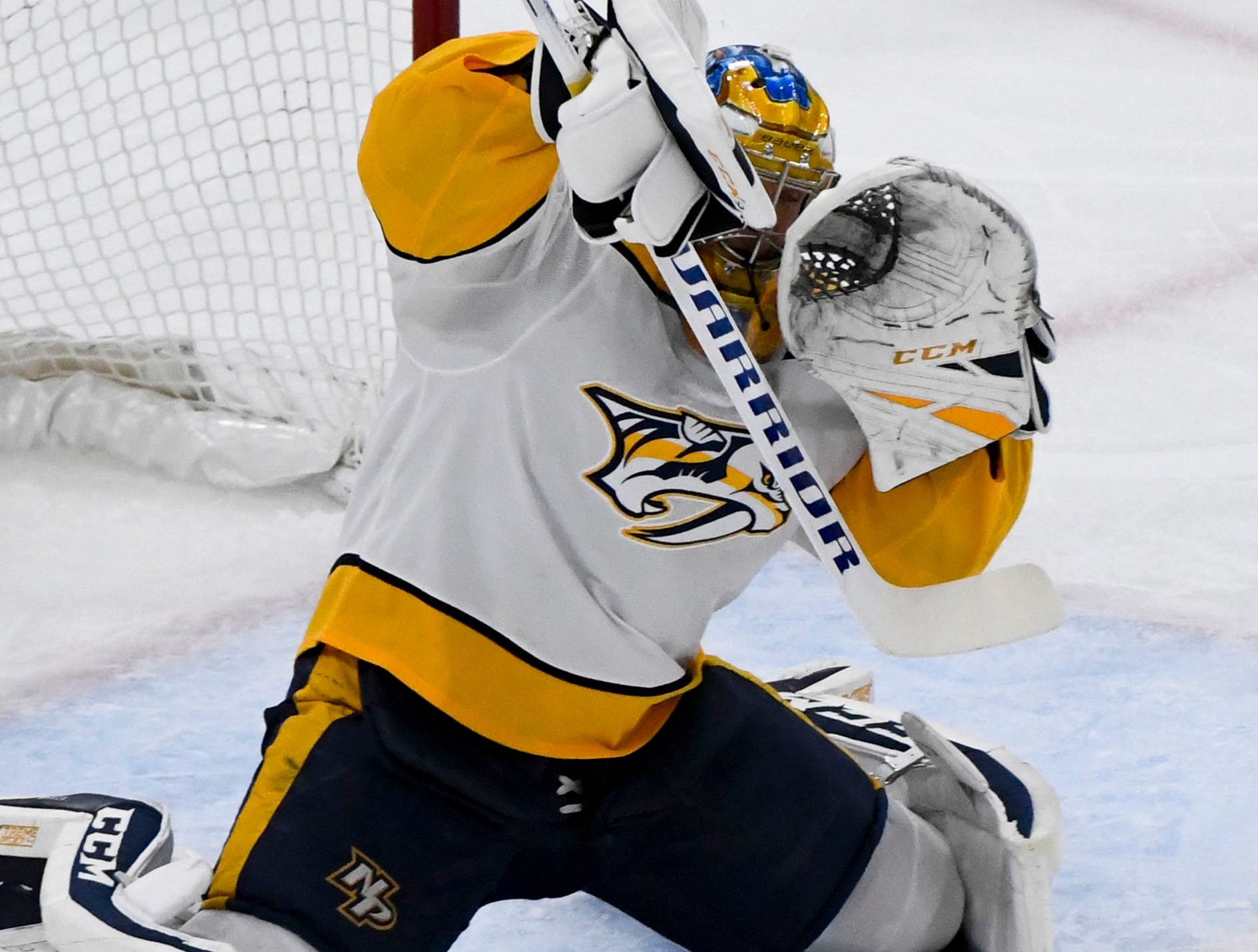 Dec 18, 2018; Chicago, IL, USA; Nashville Predators goaltender Pekka Rinne (35) blocks a shot from the Chicago Blackhawks during the first period at the United Center.