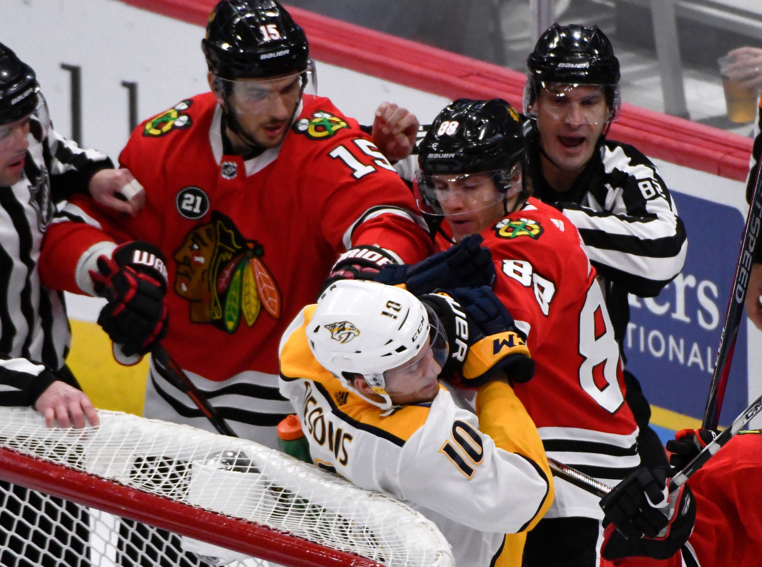 Dec 18, 2018; Chicago, IL, USA;Nashville Predators center Colton Sissons (10) fights with Chicago Blackhawks right wing Patrick Kane (88) and Chicago Blackhawks center Artem Anisimov (15) during the first period at the United Center.
