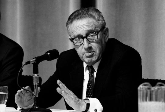 Former secretary of state Henry Kissinger answers a question during a press conference at David Lipscomb College on Dec. 9, 1988, before the sixth annual Conference of the Former Secretaries of State held at The Tennessee Performing Arts Center.