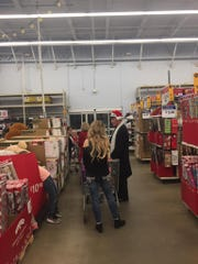 Musician Ronnie McDowell and the Portland Police Department took Portland children Christmas shopping Dec. 19 for the Ronnie McDowell Annual Shopping Tour for Kids.
