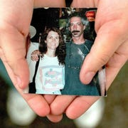 Tara Cronk keeps a photograph of her mother MaRiah Cronk-Kahn and her stepfather Julian Saul Kahn in her car. On December 14, 1998, MaRiah was killed by Julian, who then killed himself .