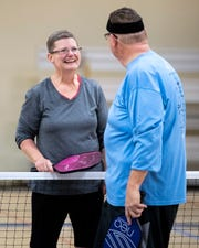 Julie Nidiffer laughs with her husband Jerry Nidiffer after a game of pickleball at the Gordon Jewish Community Center in Nashville, Tenn., Wednesday, Dec. 19, 2018.
