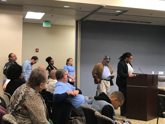 Members of Stand Up Nashville speak out during a meeting of the Metro Industrial Development Board.