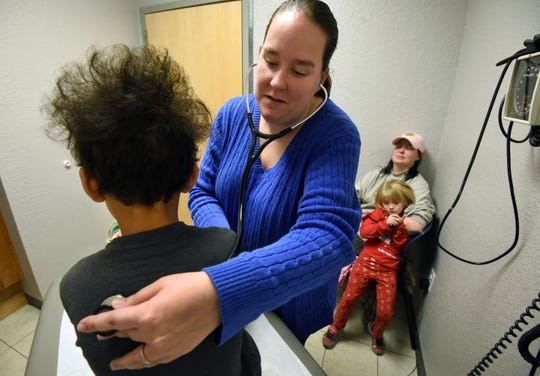 Physician assistant Lauren Anderson checks Liam Hicks, 8, during an examination at the Servolution Health Services in Speedwell, TN Thursday, Dec. 20, 2018.  TennCare has suspended certain payments to any new rural health clinic in Tennessee while it comes up with new payment rules.