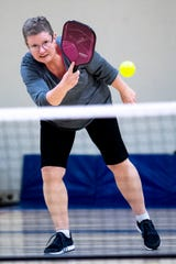 Julie Nidiffer hits the ball during a game of pickleball at the Gordon Jewish Community Center in Nashville, Tenn., Wednesday, Dec. 19, 2018.