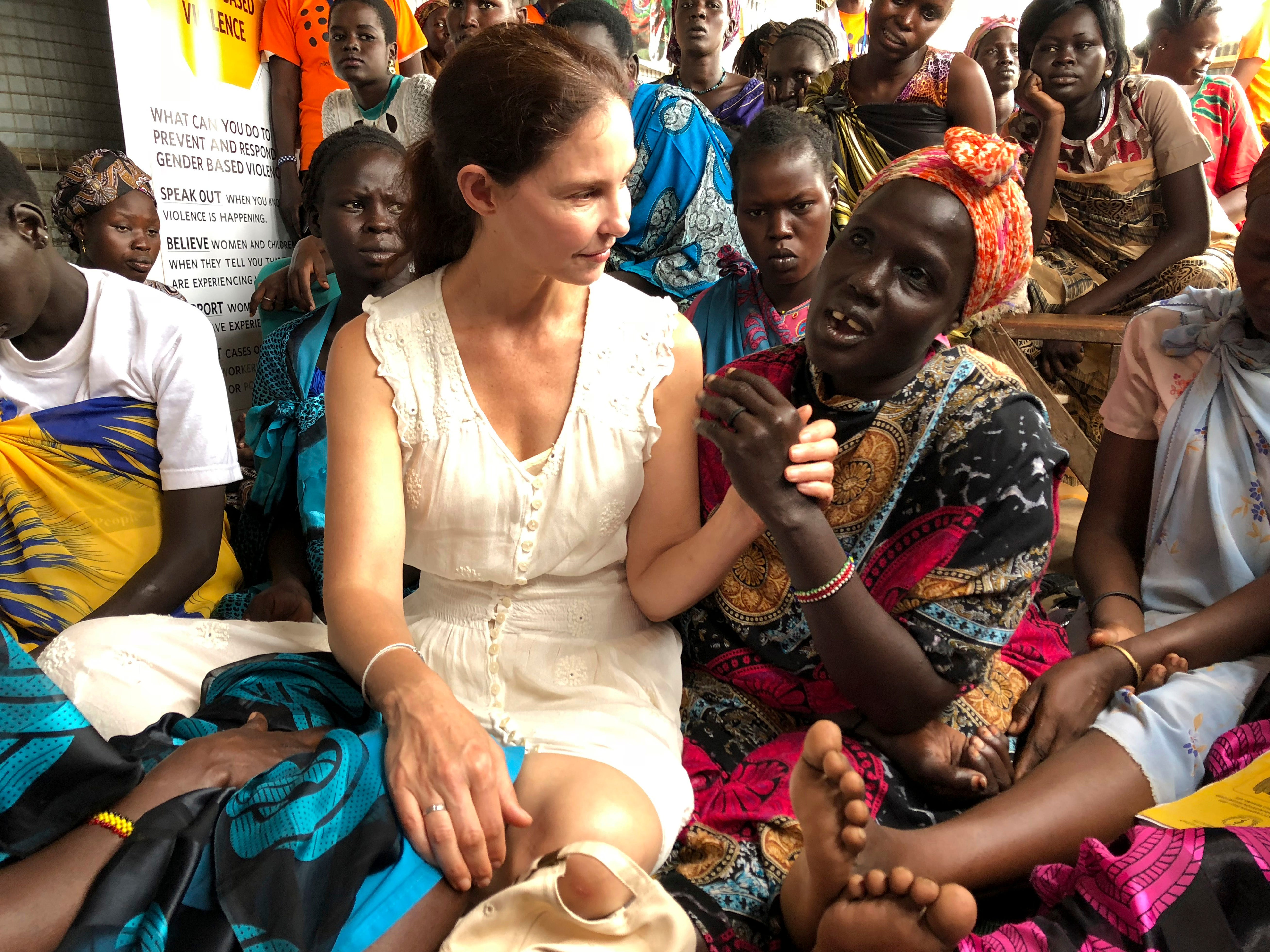 "Actress Ashley Judd meets refugees in Juba, South Sudan, Thursday, June 28, 2018. In her first visit to civil war-torn South Sudan, Ashley Judd had a message for survivors of sexual assault in a country where rape is a widespread weapon. ""I see you, I love you and I'm here for you,"" she said in an interview with The Associated Press."