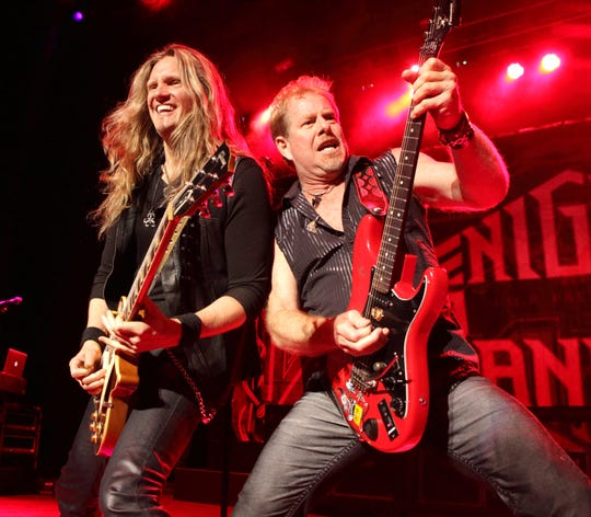 Joel Hoekstra and Brad Gillis of the rock band Night Ranger perform April 26, 2014, in Columbia, Md. (Photo by Owen Sweeney/Invision/AP)