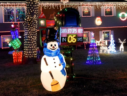A snowman advertises six day until Christmas on Wednesday, Dec. 19, 2018.