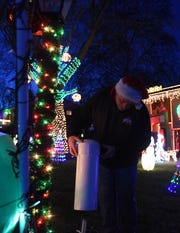 Kenny Riley shows off his PVC pipping solution to protect plug as part of his annual Christmas lights display at his Heath home.