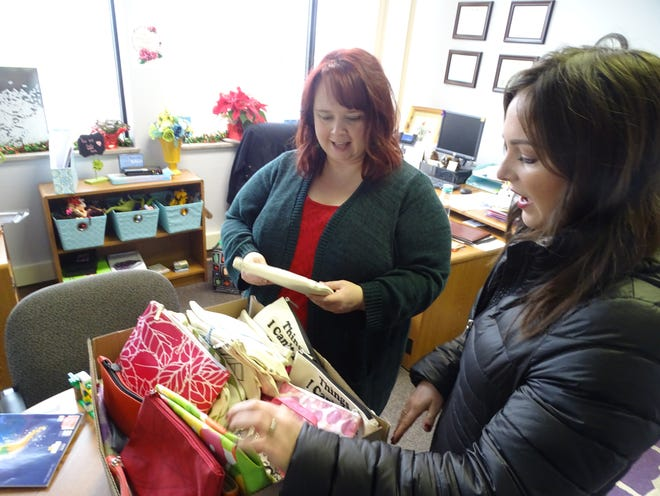 Kikersville resident Jessica Forsthoefel (right) and Kelly Campbell, The Woodlands director (left), take a look at the approximately 60 toiletry bags Forsthoefel delivered to The Woodlands' office on Thursday morning.