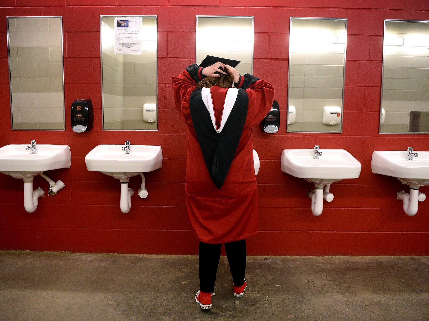 The 252nd commencement of Rutgers University was held at High Point Solutions Stadium in Piscataway on Sunday, May 13, 2018. Abigail Harriman of New Brunswick, adjusts her cap, prior to graduation.