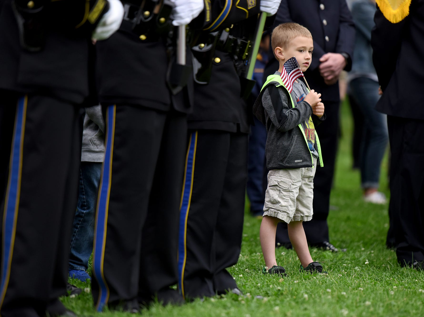 The Clifton Memorial Day parade was held on Monday, May 28, 2018. Trevor Nicol 4, of Clifton, lines up among the Clifton department during a ceremony at Chelsea Memorial Park. Nicol's uncle is a Clifton police officer.