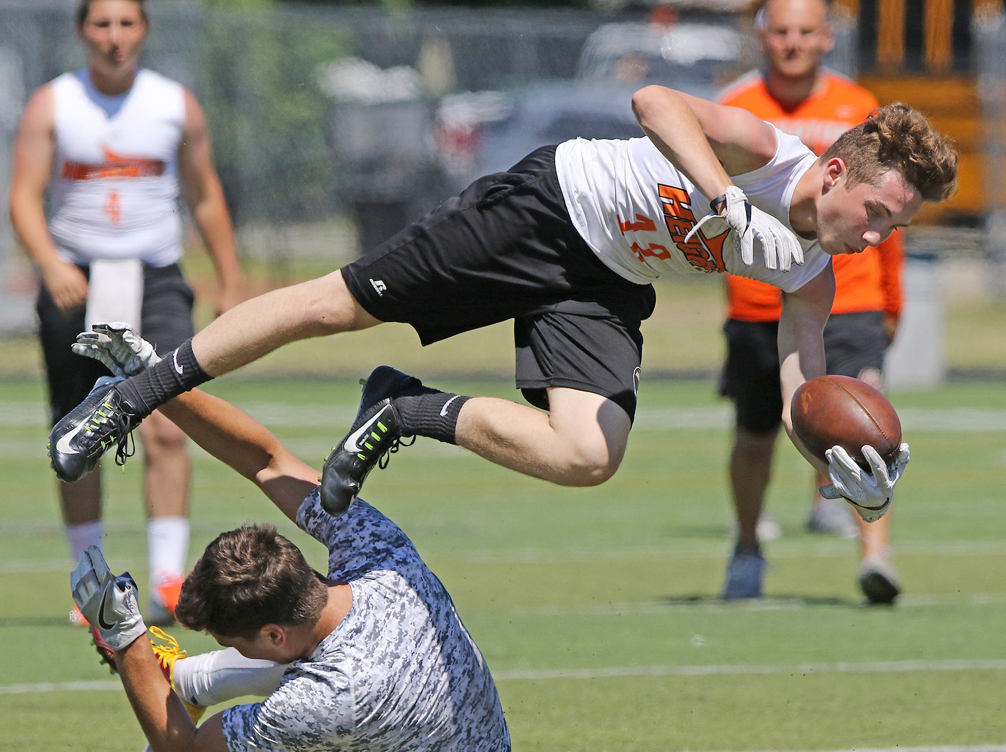 Dylan Grisase of Hasbrouck Heights is upended after making this catch in the championship game against Park Ridge.Pedota POY 2018