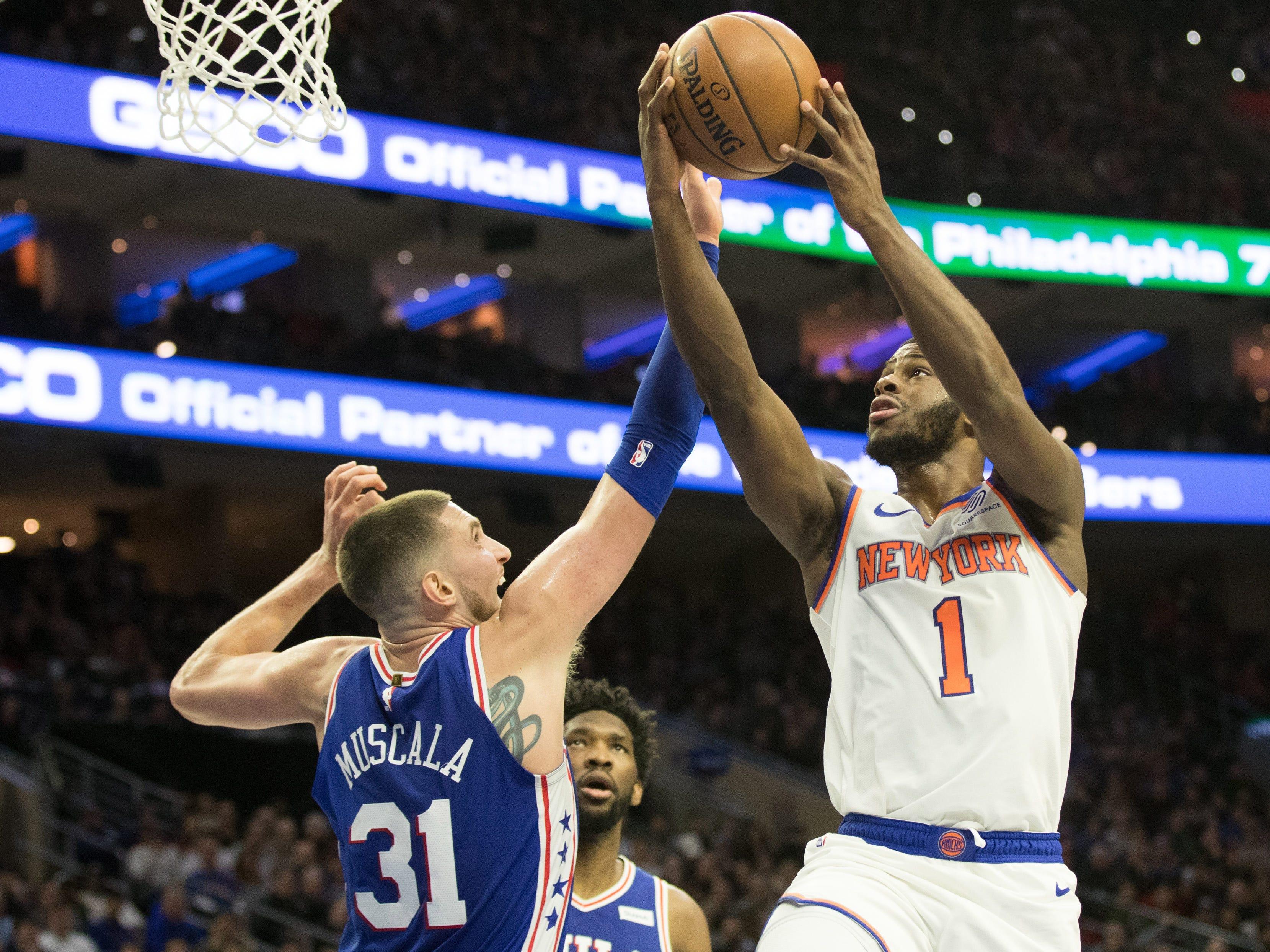 Dec 19, 2018; Philadelphia, PA, USA; New York Knicks guard Emmanuel Mudiay (1) shoots as Philadelphia 76ers forward Mike Muscala (31) defends during the second quarter at Wells Fargo Center.