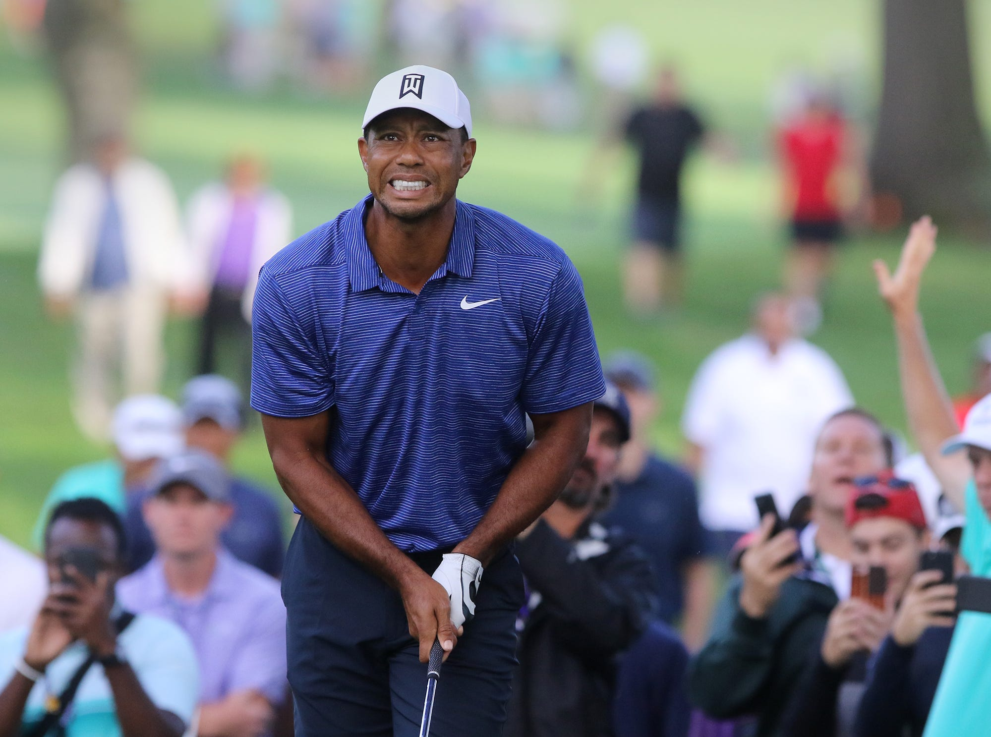 Tiger Woods watches his ball after hitting it out of the rough on the 10th hole to start his first round of the Northern Trust PGA at the Ridgewood Country Club in Paramus, NJ.Pedota POY 2018