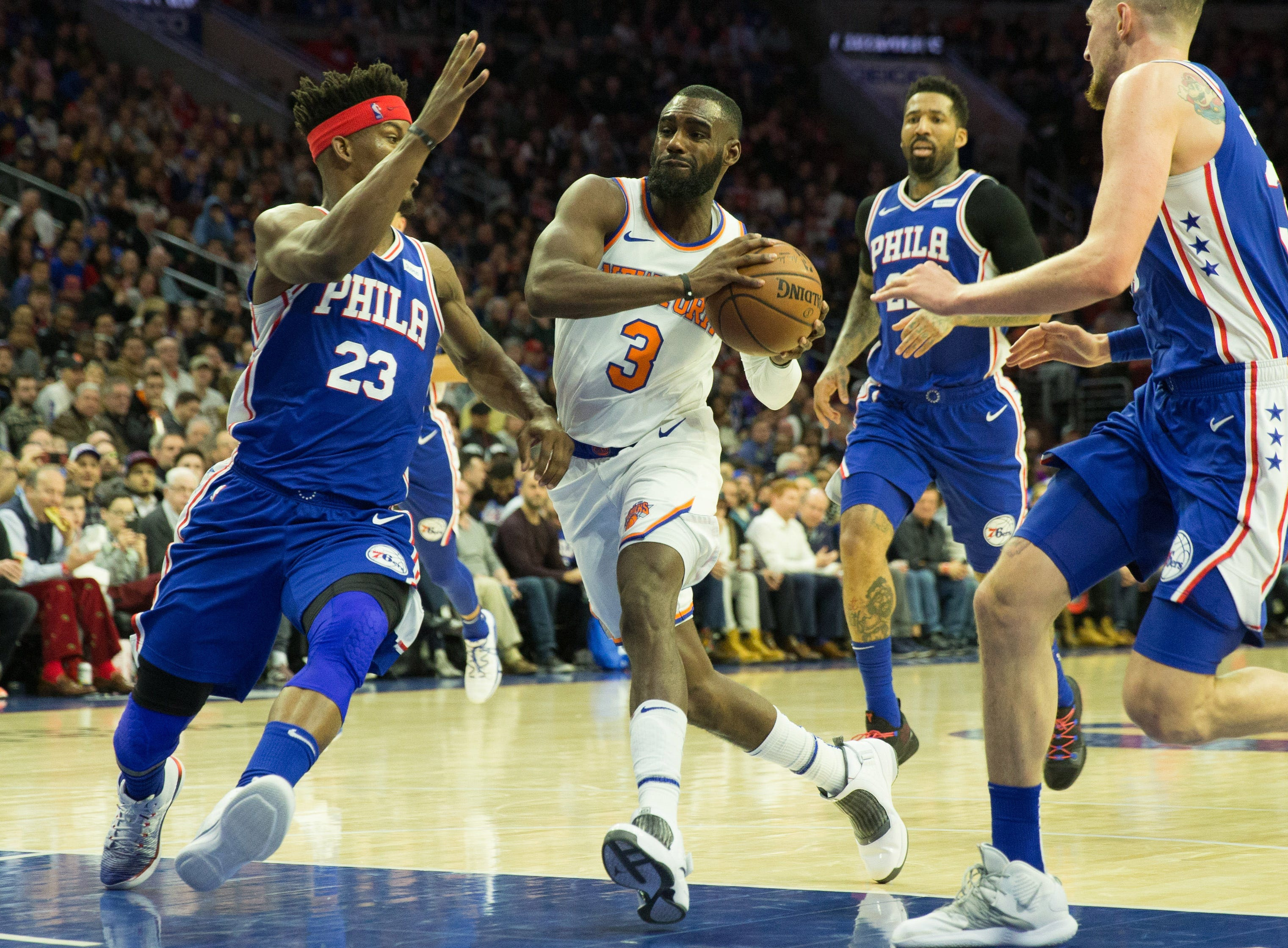 New York Knicks guard Tim Hardaway Jr. (3) drives against Philadelphia 76ers guard Jimmy Butler (23) during the second quarter at Wells Fargo Center.