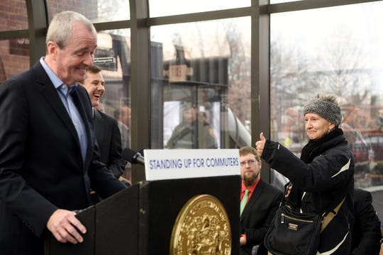 """Commuter Lynne Kalustian of Chatham gives Gov. Phil Murphy a thumbs up """"I voted for you,"""" she said, while walking to her train in the Summit Train Station. Kalustian got a laugh from Gov. Murphy Senator Tom Kean Jr. (R). Gov. Murphy signed legislation to reform NJ Transit's governance and management to improve service and reliability for NJ commuters at the Summit Train Station on Thursday, December 20, 2018."""
