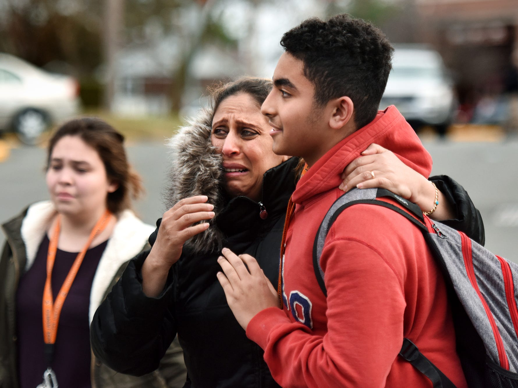 Olivia Rahman is overcome with emotion as she sees her son Joseph after he is released from lockdown at Dumont High School. Rahman had passed out earlier while waiting for her son and was taken away in an ambulance, but was back in time to greet her son as he was released from school. Dumont High School was placed under lockdown on Monday afternoon after a threat was found on social media from a fifteen year-old sophomore. The student was arrested at 1:15 p.m. and students were released from school around four o'clock after the school was searched on Monday February 26, 2018.