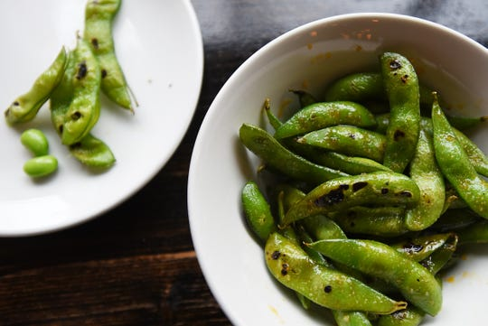 Sheree Sarabhaya and her son Luck Sarabhayavinija both own restaurants on Bloomfield Avenue in Montclair. A plate of chili charred edamame shown on Thursday December 20, 2018.