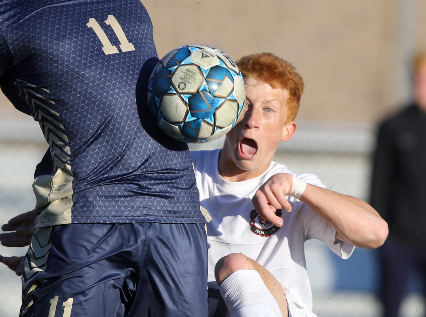 Ben Zakowski heads the ball in the second half while being defended by Brendan Bussiere.Pedota POY 2018