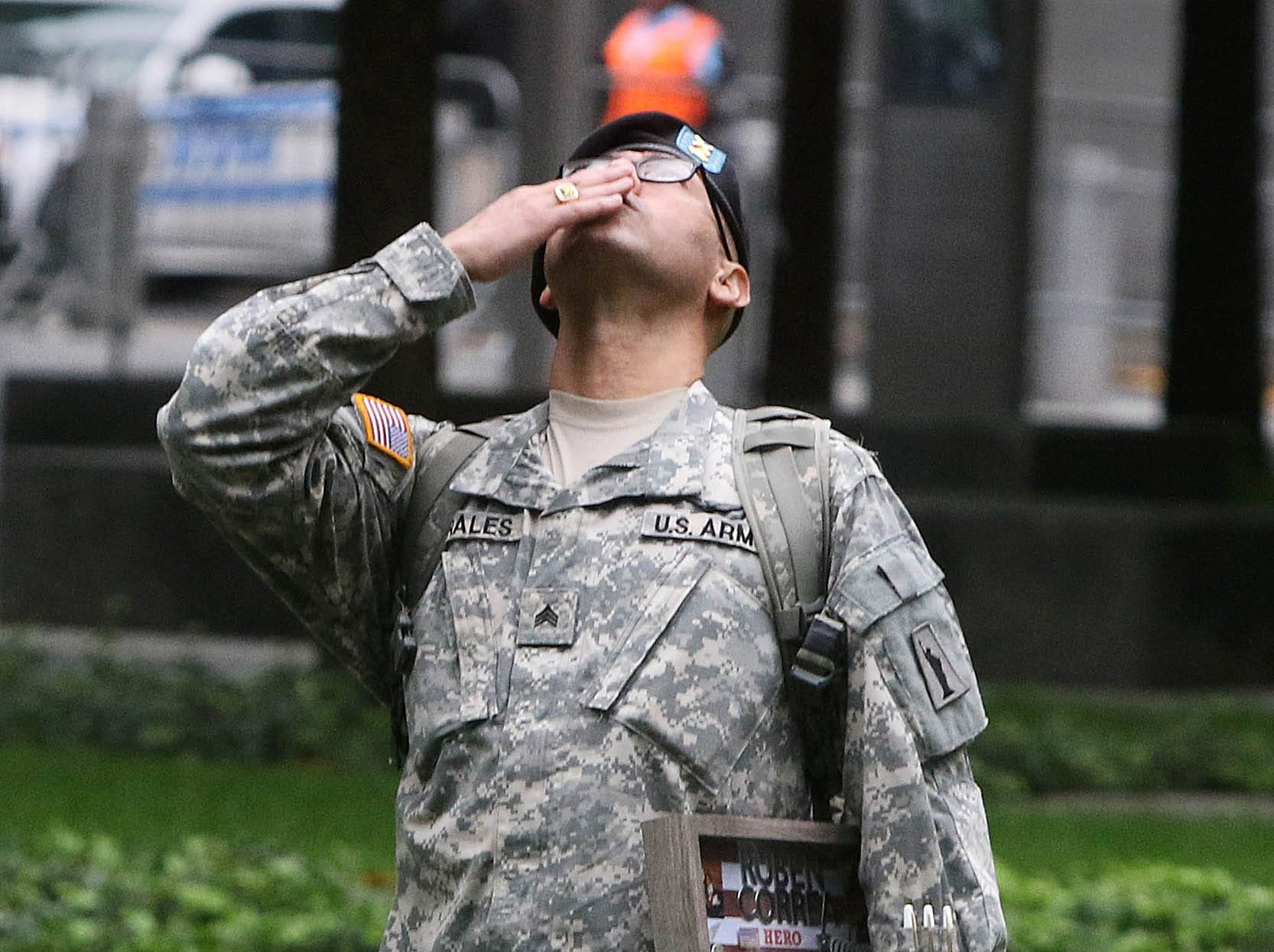 Army Sgt. Edwin Morales of the Bronx kisses up to the sky as part of honoring his cousin, RubenCorrea a NY firefighter who died on 911.  This was done during the ceremonies at the National September 11 Memorial observing the 17th anniversary of the attacks that killed people in Manhattan, the Pentagon, Flight 93 and honoring those who died in the 1993 World Trade Center bombing. Pedota POY 2018