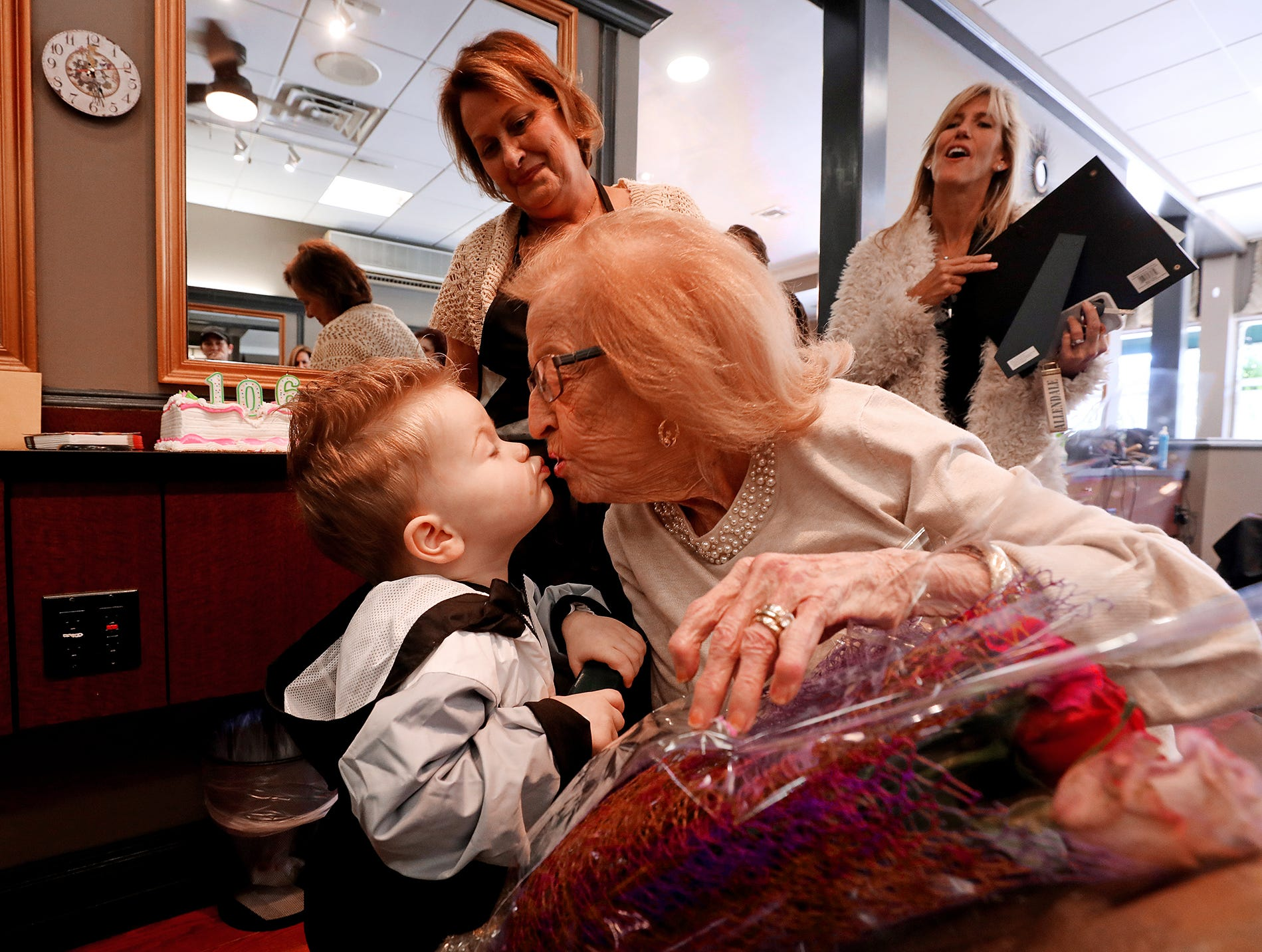 Brett Leo Devine 2 of Maywood kisses his great grandmother Susan Keane as part of her 106th birthday celebration.Pedota POY 2018