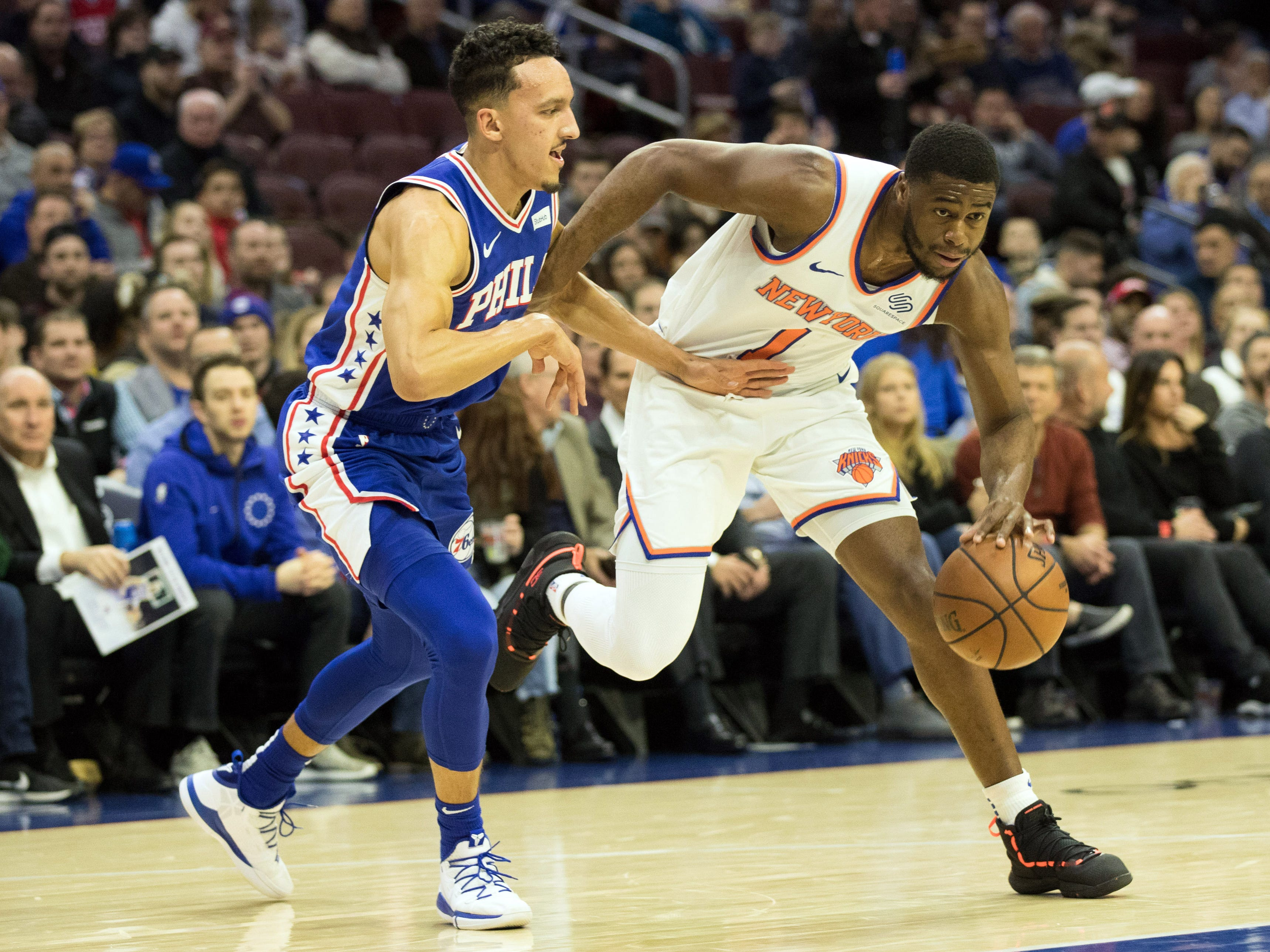 Dec 19, 2018; Philadelphia, PA, USA; New York Knicks guard Emmanuel Mudiay (1) dribbles as Philadelphia 76ers guard Landry Shamet (1) defends during the first quarter at Wells Fargo Center.
