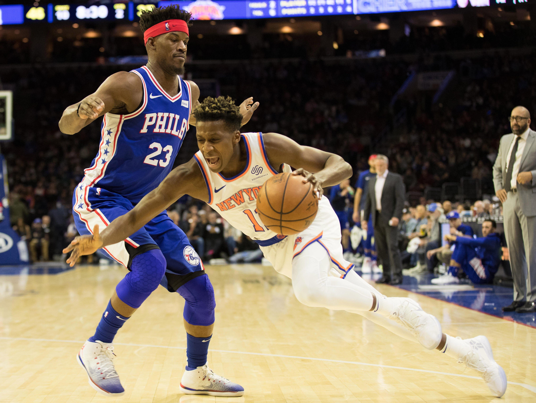 Dec 19, 2018; Philadelphia, PA, USA; New York Knicks guard Frank Ntilikina (11) drives to the basket against Philadelphia 76ers guard Jimmy Butler (23) during the second quarter at Wells Fargo Center.