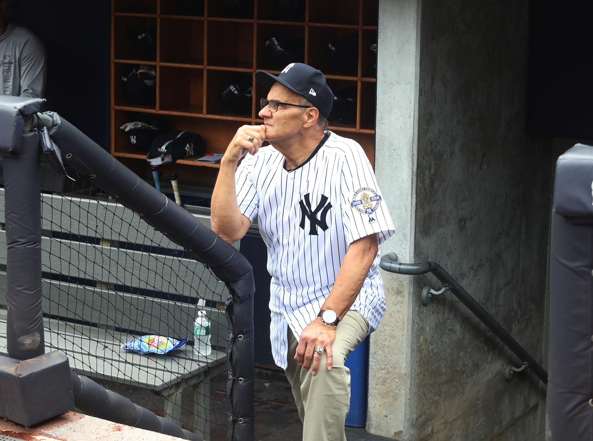 Former manager Joe Torre on the steps of the Yankee dug out where he was when the Yankees won the World Series in 1998. The 98 Yankees came back to celebrate the twentieth anniversary of their World Series win.Pedota POY 2018
