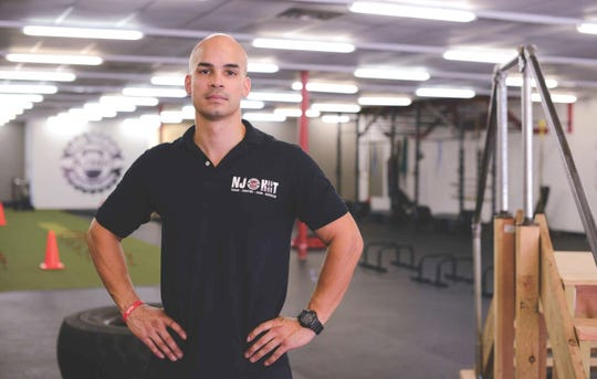 Jose Soto, founder and owner of NJ HIIT Fitness and full-time firefighter