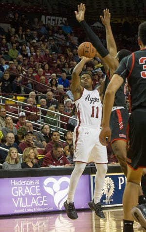 New Mexico State's Keyon Jones and the Aggies open WAC play on Thursday at league newcomer California-Baptist.