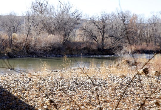 The Animas River flows near the Miller Street Bridge in Farmington's metropolitan redevelopment area. A draft MRA plan calls for making the Animas District n hub for outdoors manufacturing and creating another park near the Animas River.