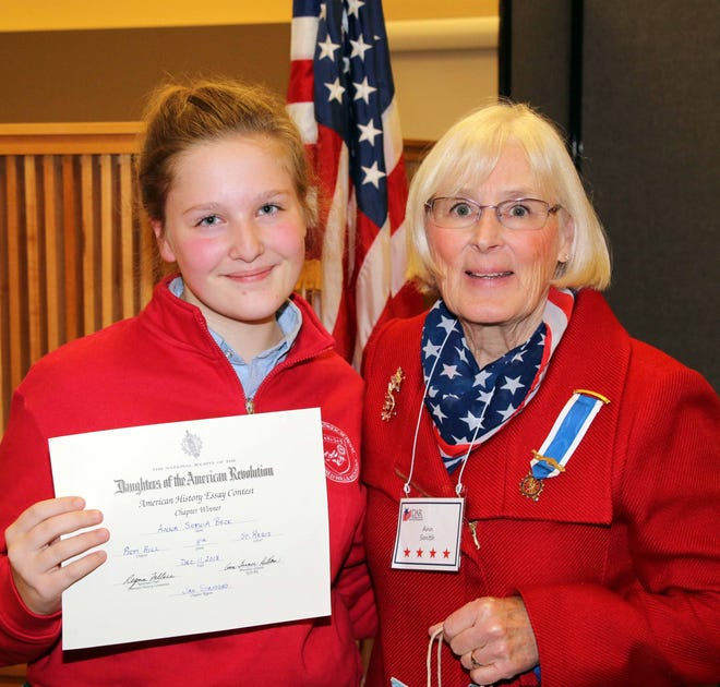 Eighth-grade winner Anna Sophia Beck with DAR Piety Hill member co-chair Ann Smith.