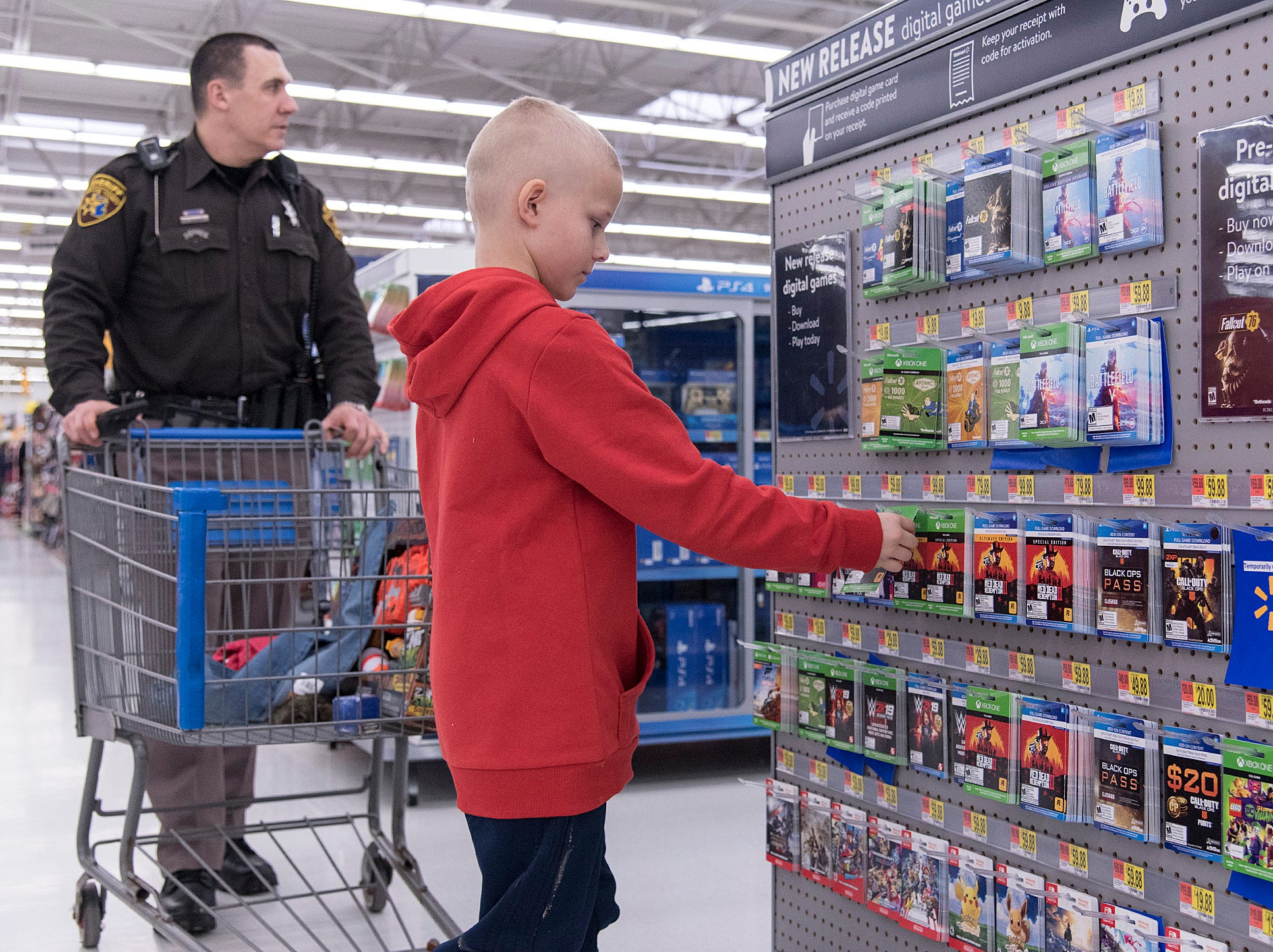 Jayden Paradis looks for gift cards but decides they're too expensive.