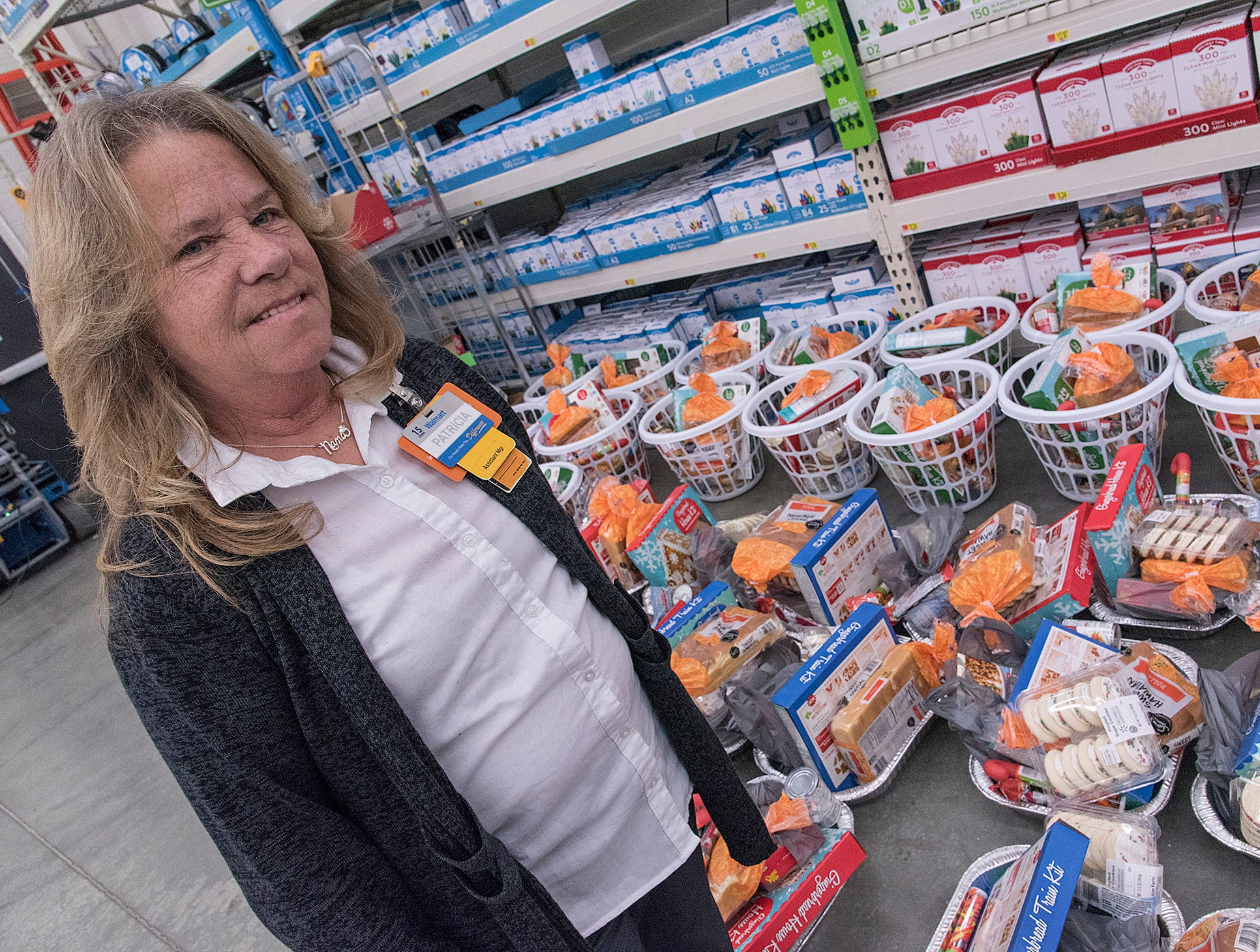 Walmart Assistant Manager Patricia Braidwood tells us that Walmart's food basket donation will go to the families in the program.