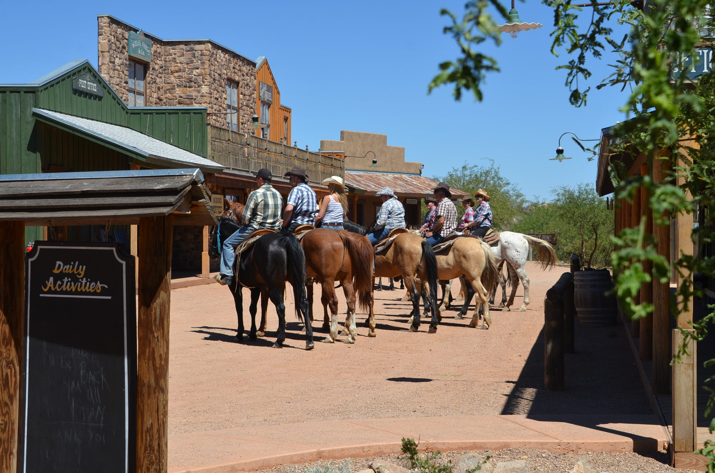 A group horseback ride at Tombstone Monument Ranch