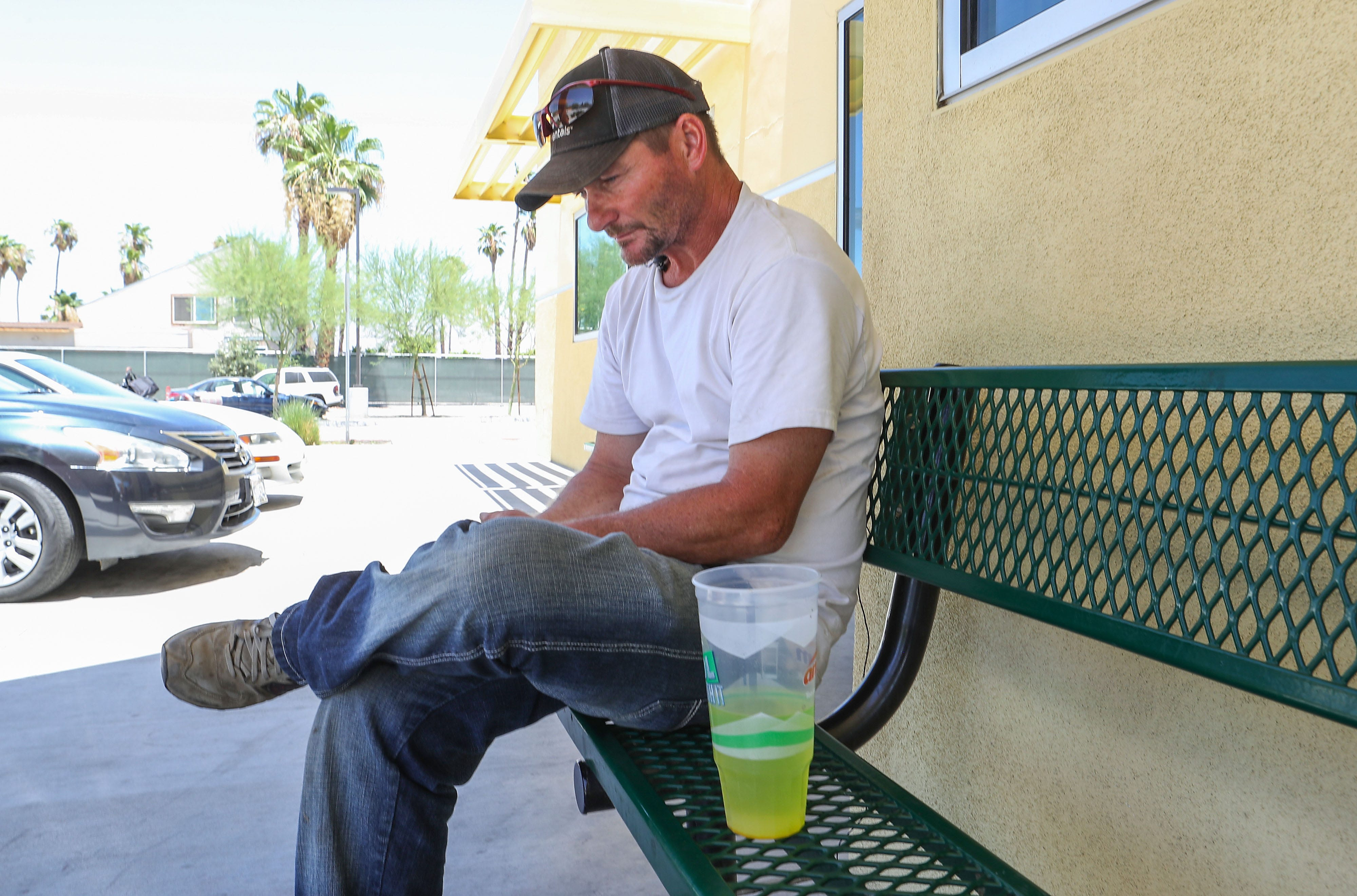 Robert Pruitte passes time at the Coachella Valley Rescue Mission on June 29, 2018, after being evicted from the Coachella encampment near Dillon Road. He stayed at the mission on and off during the summer as he worked through the housing process.