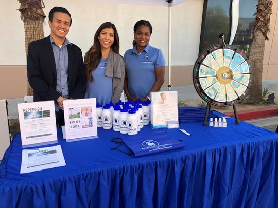 L-R Ryan Nuqui, MD, Victoria Nuqui, Yvonne Rodriguez, CCMA-A,CCMA, with Replenish 360 provided relief, goodies, and education