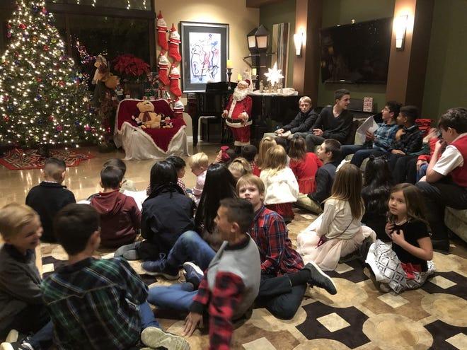 The children eagerly awaited Santa's arrival.
