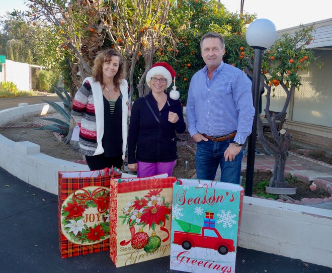 Santa's helpers: (L) Dena Bates, Lisa Jamieson and Chris O'Hanlon