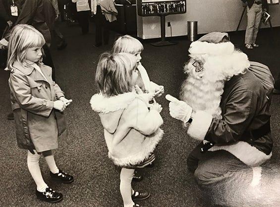 Santa visits children at the airport, 1977