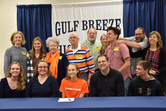 Hannah Spooneybarger, seated center, is joined by her parents, family and relatives during an event Dec. 13 to celebrate her signing with Carson-Newman during the NCAA early signing period.