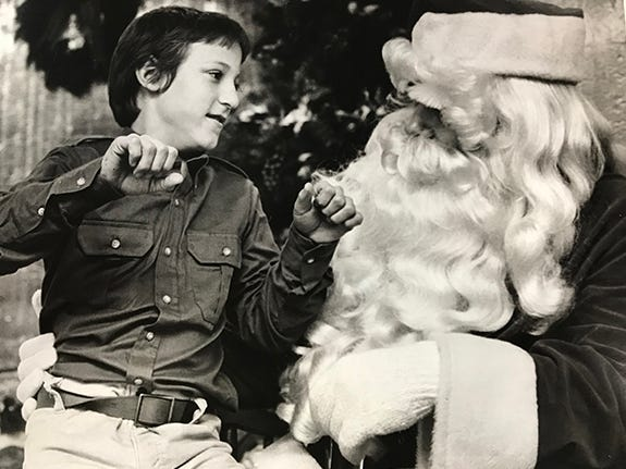 A deaf boy tells Santa that he wants a bicycle for Christmas, 1984. Both he and Santa are deaf.